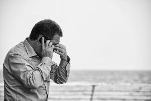 Man Overcome with Worry and Negativity Bias