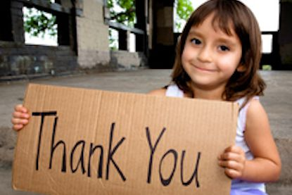 girl with thank you sign - The Concept of Gratitude