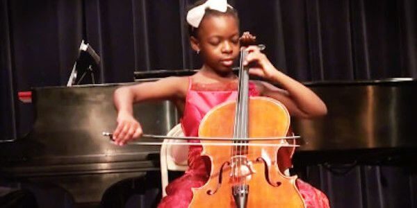 girl playing an instrument - PERMA engagement positive psychology