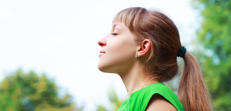 woman breathing mindfully - mindfulness