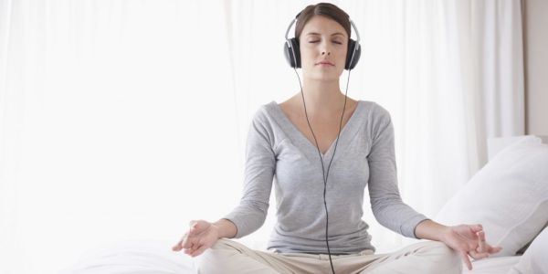 woman listening to a guided meditation - Mindfulness Meditation Script