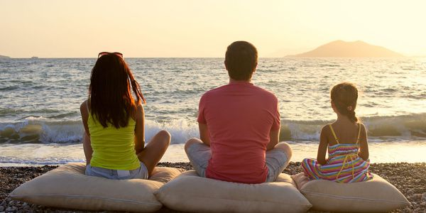 mom, dad and kid sitting on the beach - Mindfulness Meditation for Kids