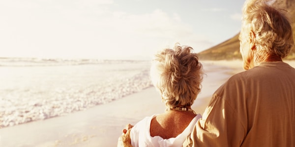 old couple on the beach - mindfulness benefits Improved General Health