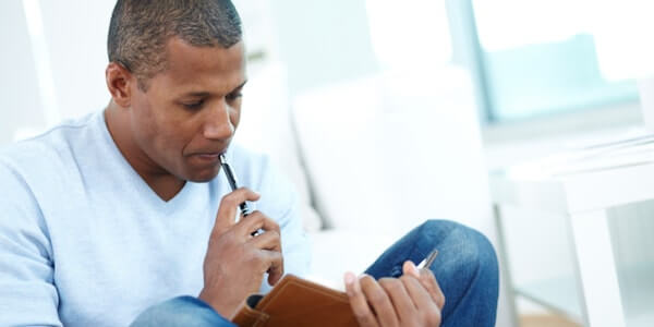 man writing - what is writing therapy journal therapy