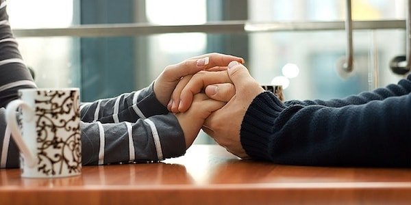 couple holding hands narrative therapy