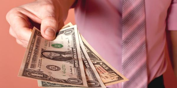 man holding money - Giving and Positive Emotion