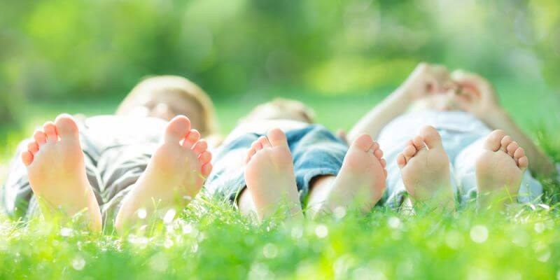 kinds laying in grass - Mindfulness Activities for Children And Teens