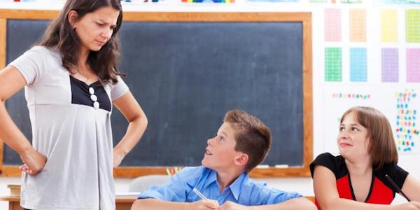 teacher and two kids - Applying Positive Punishment in the Classroom