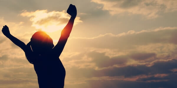 woman arms up high - The Psychology of Self-Confidence and Self-Belief